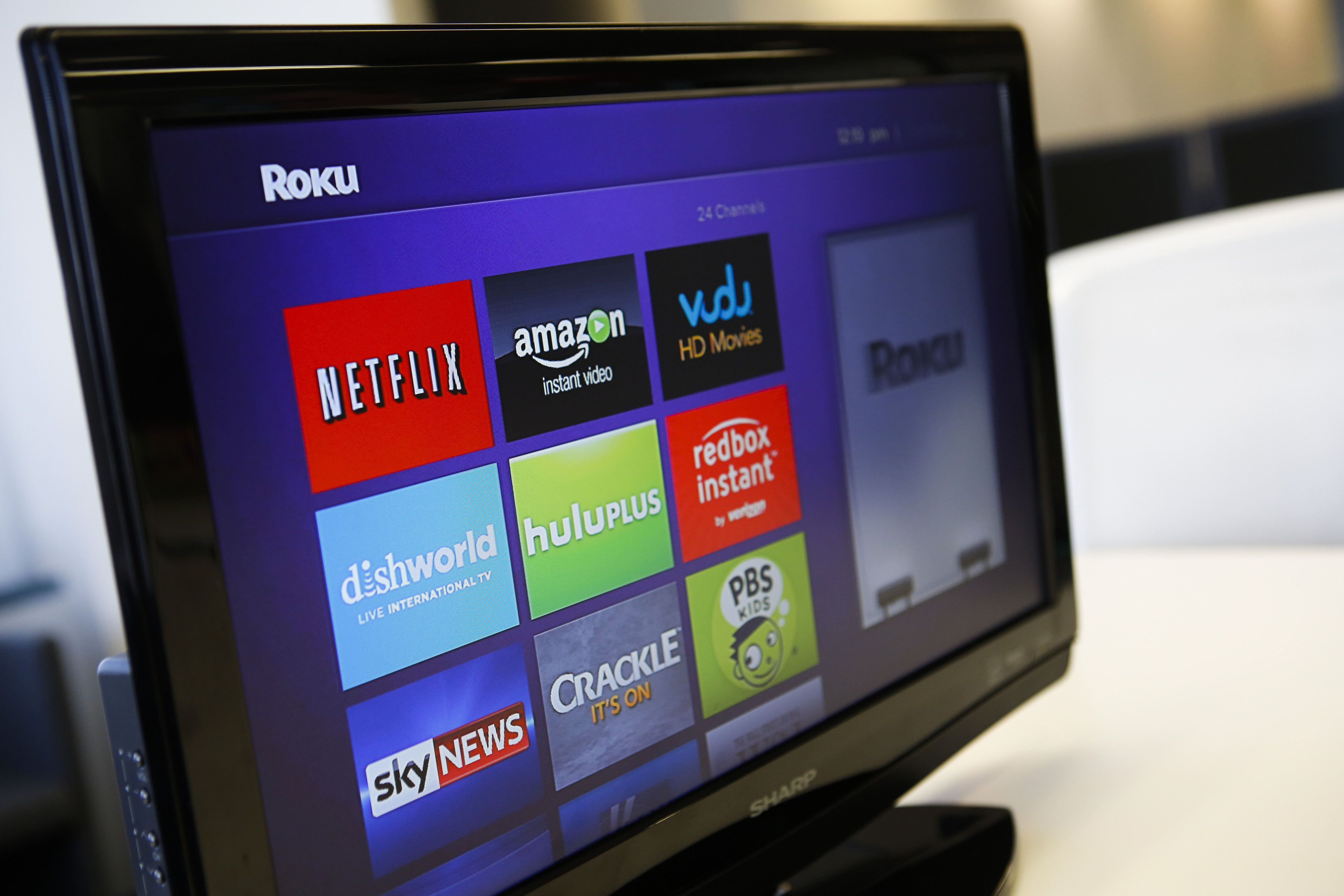 The Roku 3 television streaming player menu screen featuring Netflix, Amazon, Vudu, Hulu, and Redbox Instant is shown on a television in Los Angeles, California, U.S. Photo by Patrick T. Fallon/Bloomberg via Getty Images.