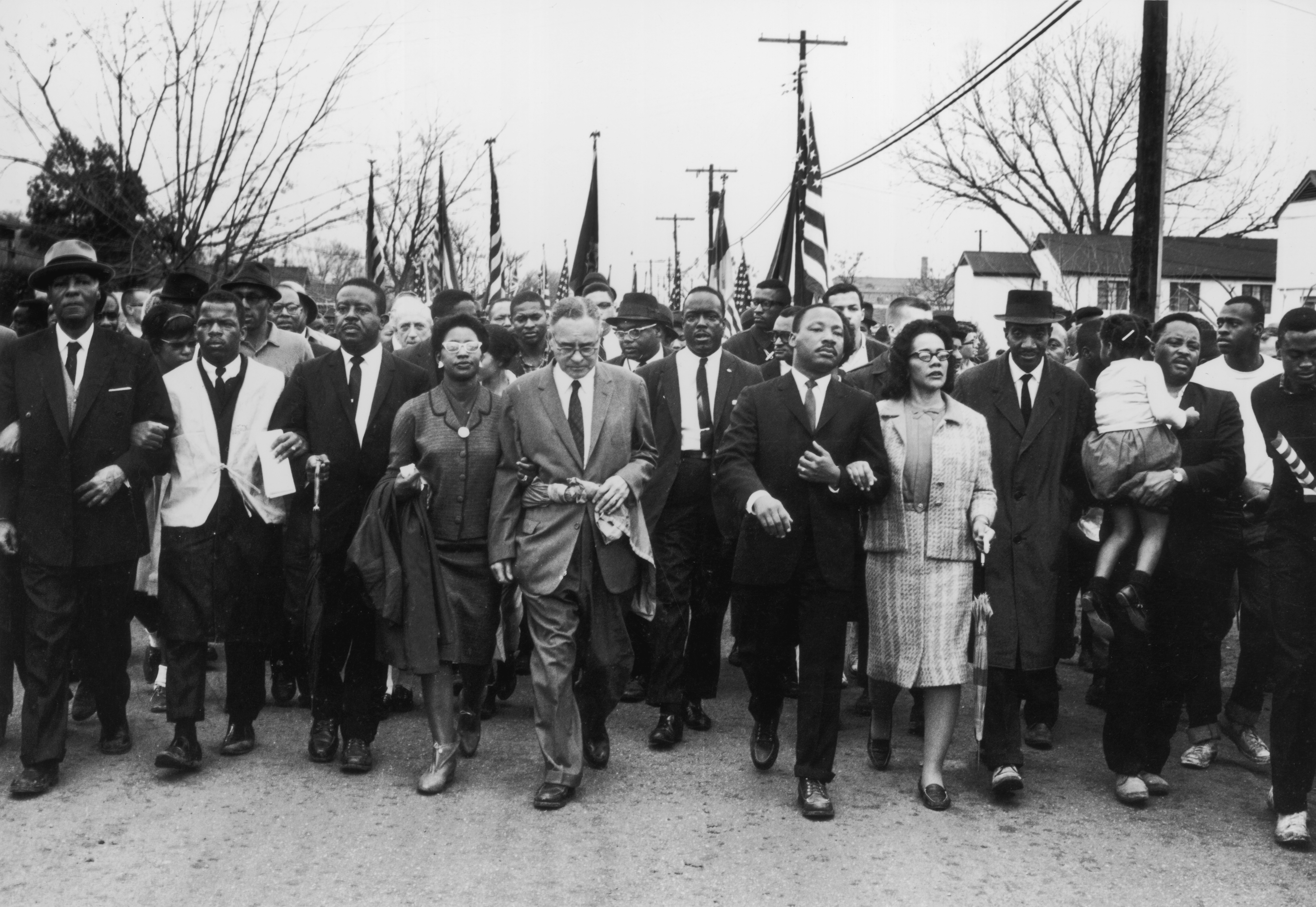 30th March 1965: American civil rights campaigner Martin Luther King (1929 - 1968) and his wife Coretta Scott King lead a black voting rights march from Selma, Alabama, to the state capital in Montgomery. (Photo by William Lovelace/Express/Getty Images)