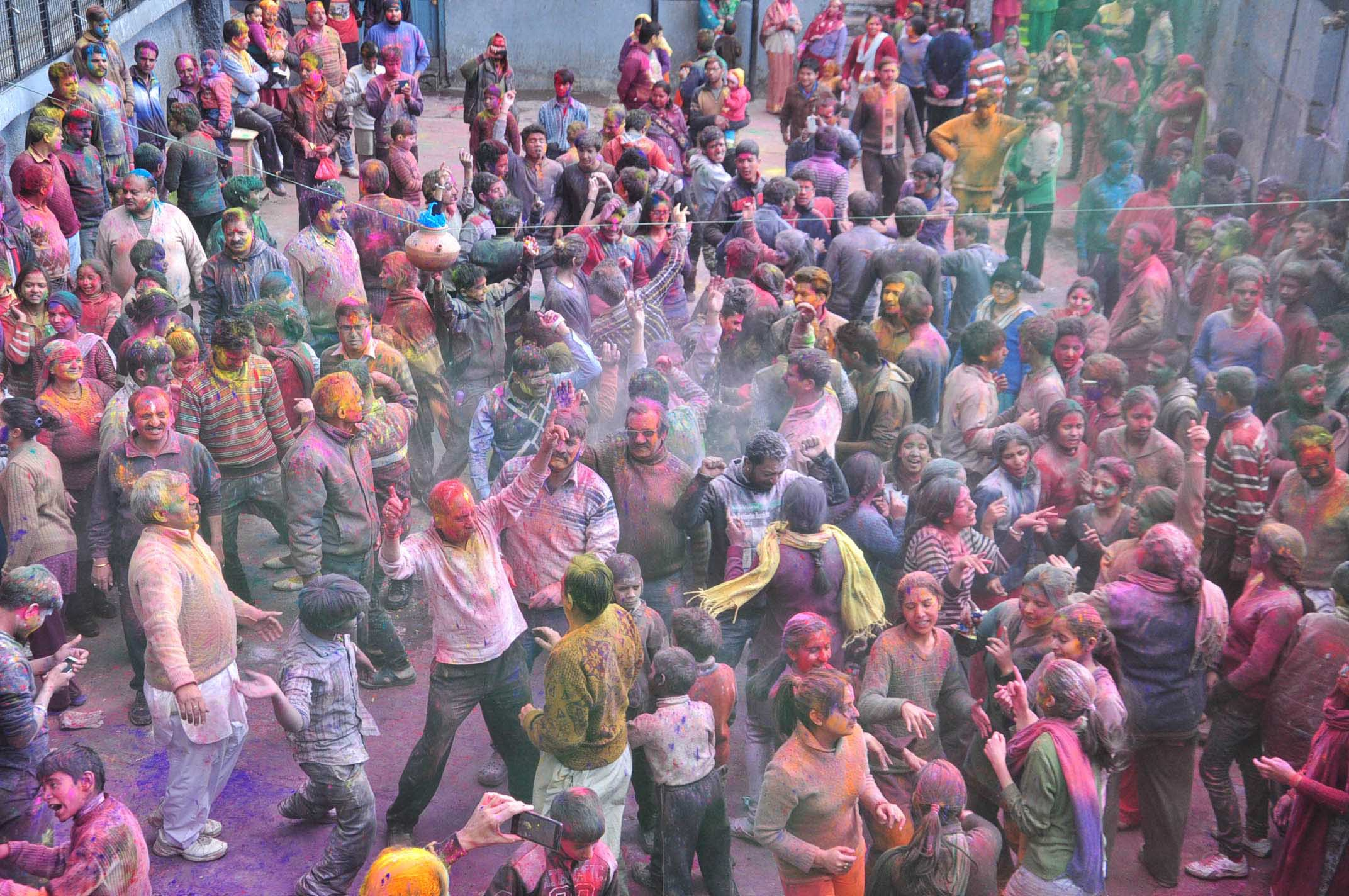 People celebrate Holi festival at Radha Krishan Temple on March 6, 2015 in Shimla, India. Photo by Santosh Rawat/Hindustan Times via Getty Images.
