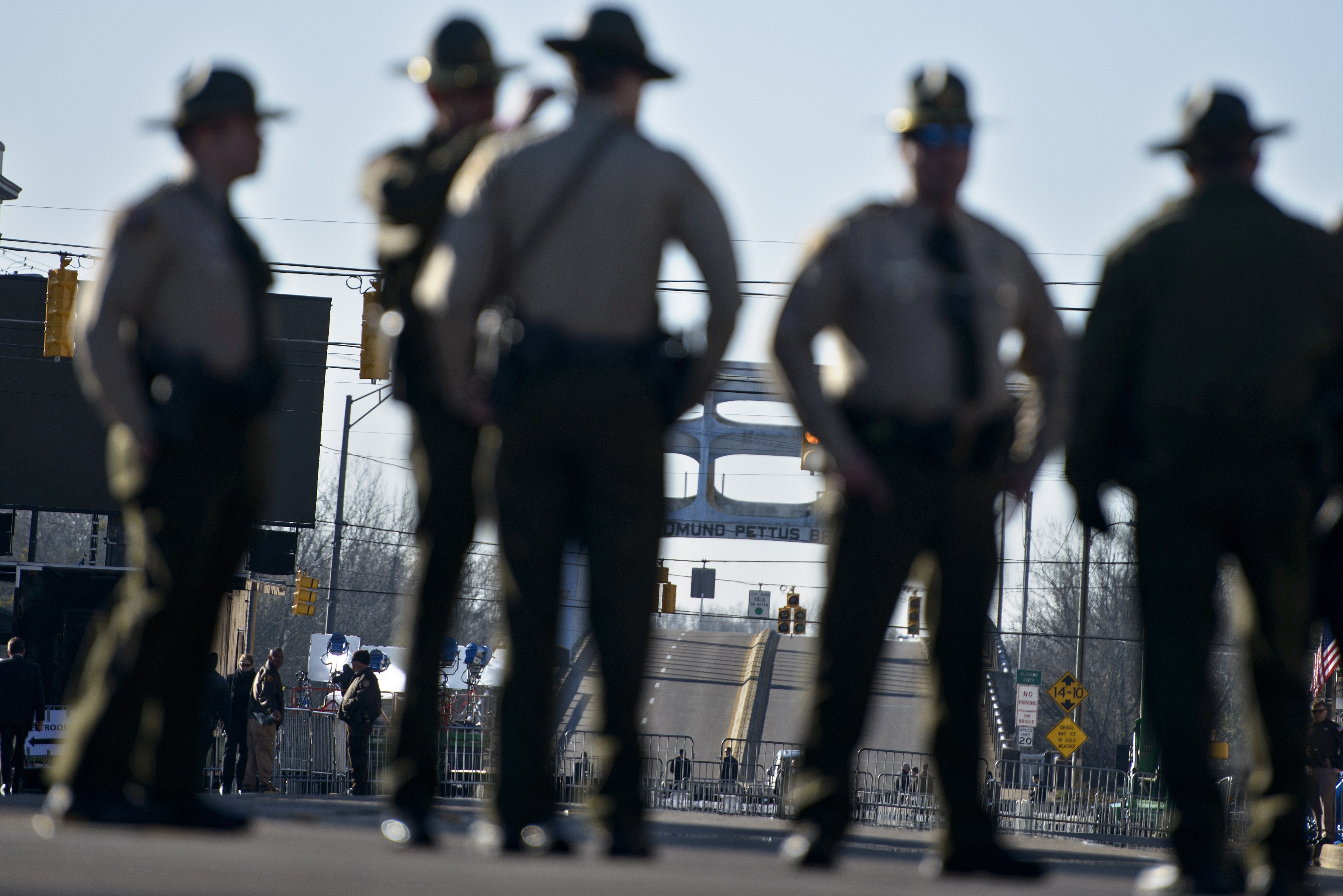 Police officers block Broad Street near the Edmund Pettus Bridge on March 7, 2015 in Selma, Alabama. US President Barack Obama and the first family will visit Selma to commemorate the 50th anniversary of Bloody Sunday, when civil rights marchers attempting to walk to the Alabama capital of Montgomery to end voting discrimination against African Americans clashed with police. AFP PHOTO/BRENDAN SMIALOWSKI (Photo credit should read BRENDAN SMIALOWSKI/AFP/Getty Images)