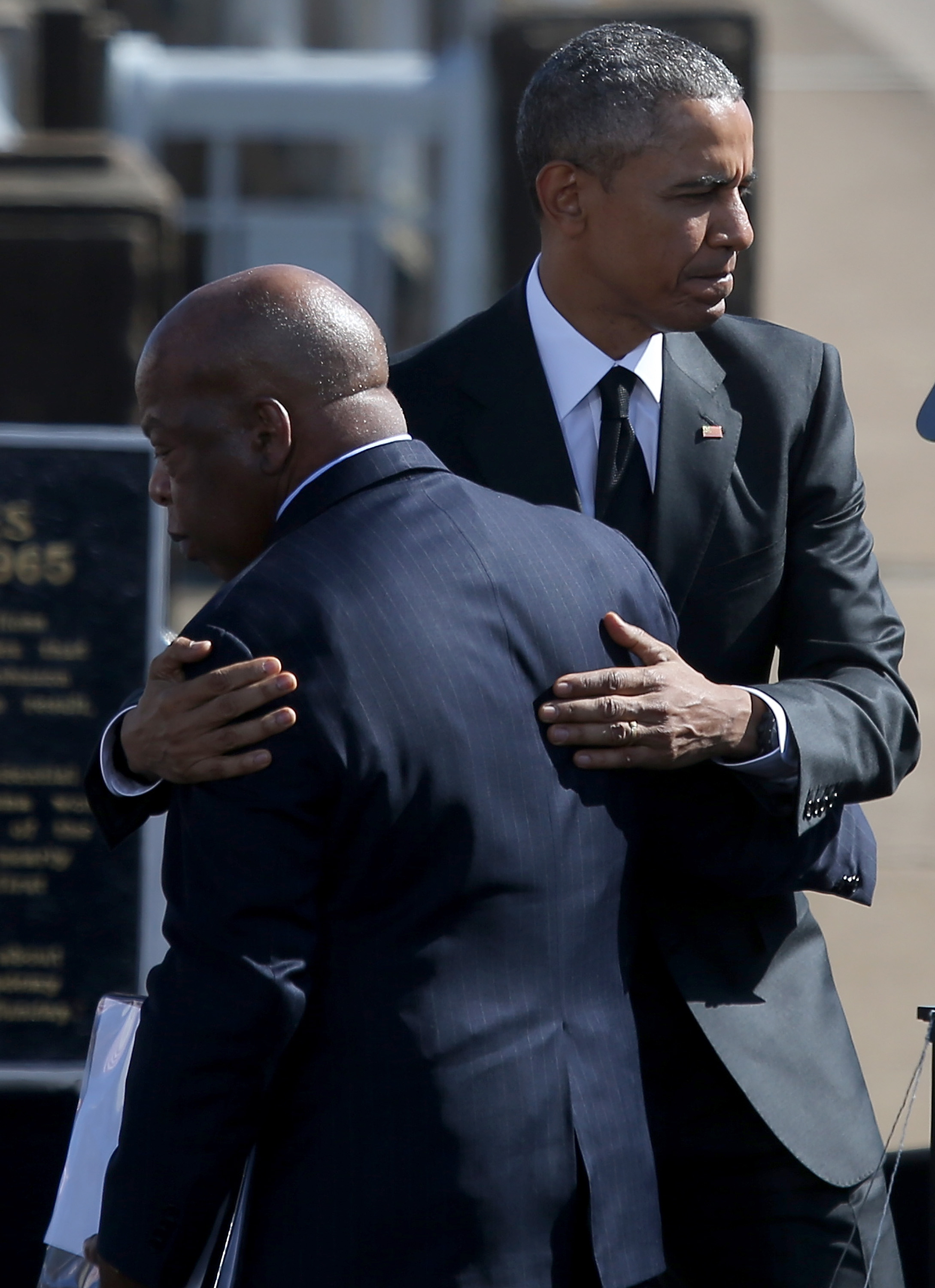SELMA, AL - MARCH 07:  U.S. President Barack Obama (R) hugs U.S. Rep John Lewis (D-GA) speaks in front of the Edmund Pettus Bridge on March 7, 2015 in Selma, Alabama. Selma is commemorating the 50th anniversary of the famed civil rights march from Selma to Montgomery that resulted in a violent confrontation with Selma police and State Troopers on the Edmund Pettus Bridge on March 7, 1965.  (Photo by Justin Sullivan/Getty Images)