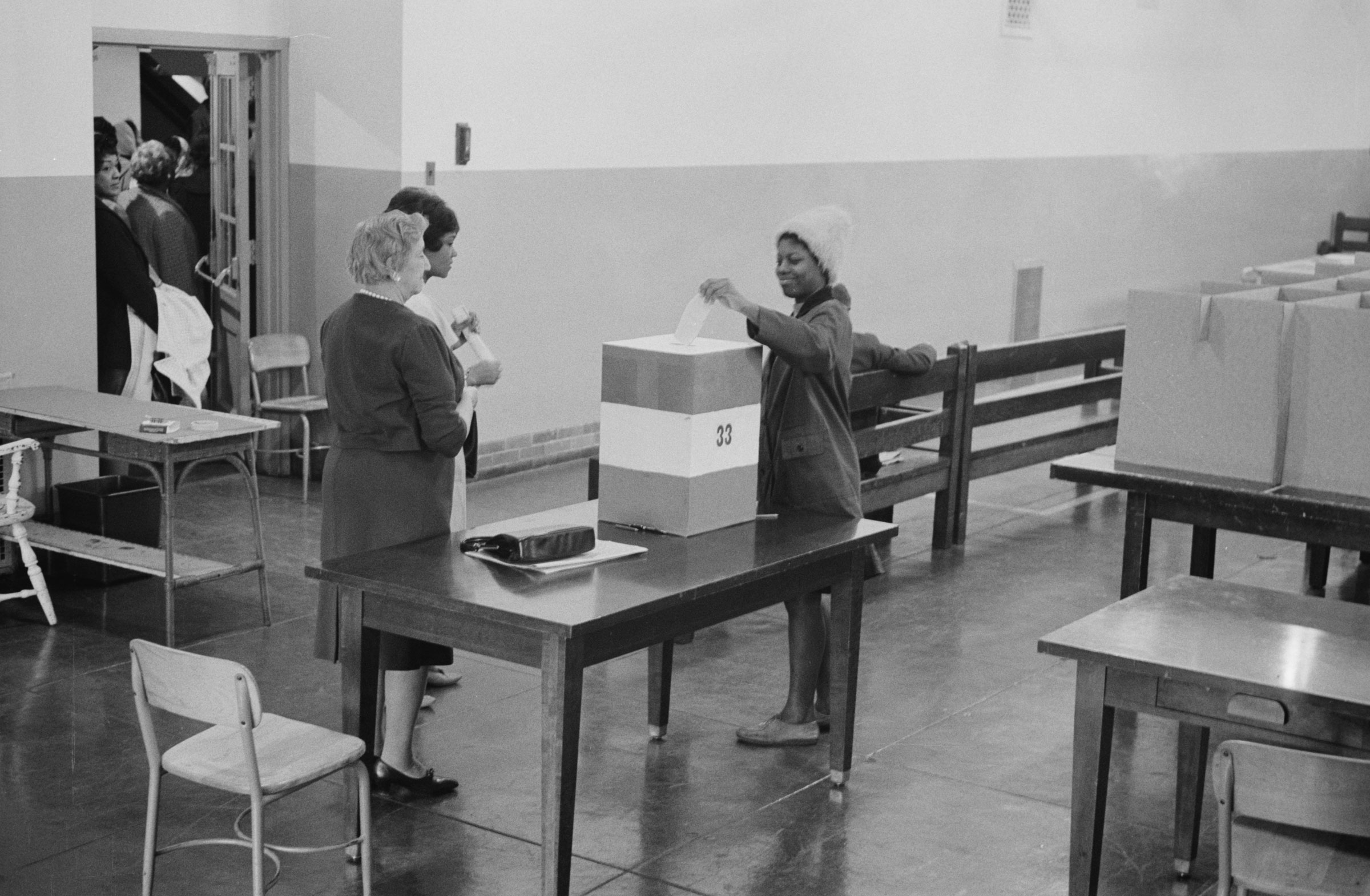 A young woman casts her ballot at Cardoza High School in Washington D.C., in this November 3, 1964 photograph courtesy of the Library of Congress. REUTERS/Library of Congress/Handout via Reuters.