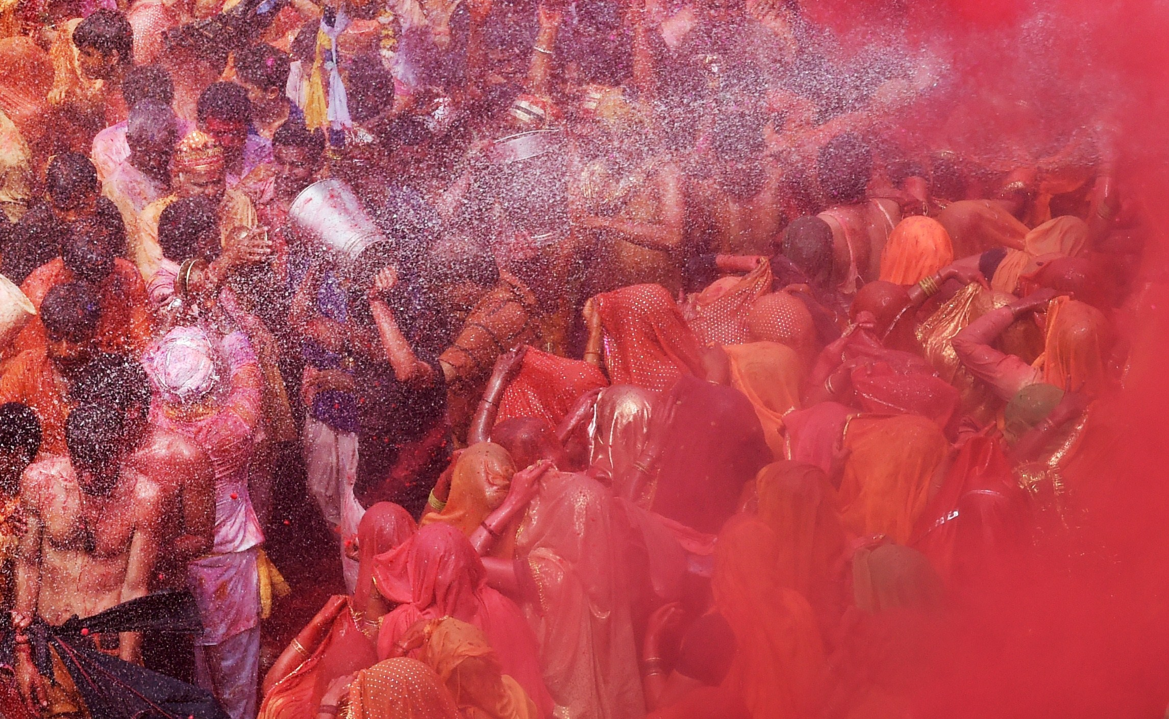 Indian men and women participate in the Dadjee ka Huranga festivities in a hindu temple in the north Indian town of Baldeo on March 7, 2015. Photo by ROBERTO SCHMIDT/AFP/Getty Images.