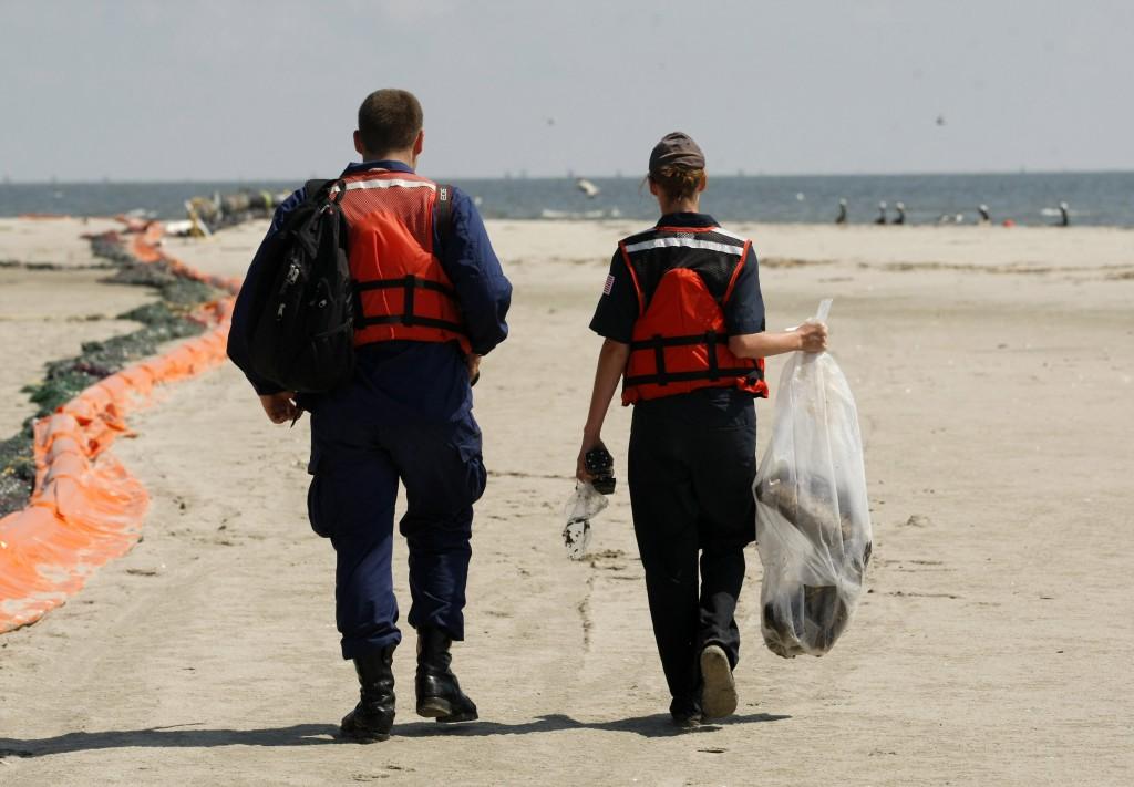 Dead Pelican Coast Guard personnel carry off the dead pelican, May 20, 2010. (AP Photo/Gerald Herbert)