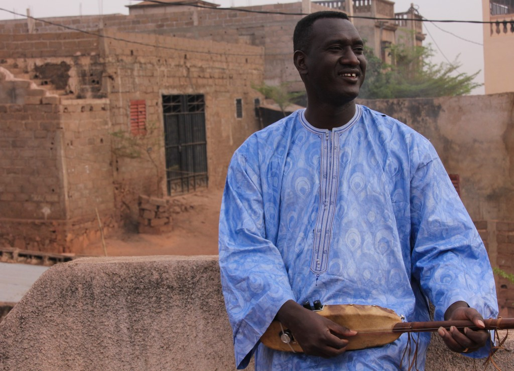 Bassekou Kouyate is one of Mali's greatest musicians and a master of the ngoni, a traditional West African lute. Bassekou – pictured here on the rooftop of a music school he's building in Bamako - has toured around the world and shared the stage with global legends like Bono; the two played together at the famed Festival in the Desert in Timbuktu just weeks before the 2012 conflict began. Photo by Molly Raskin