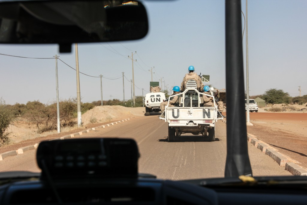 UN troops patrol the heavily secured roads surrounding the airport in Timbuktu. Peacekeeping troops in the North have come under continual attack by militants since French and Malian forces re-took the area in early 2013. Last weekend, an attack on a UN compound in the city of Kidal killed three, including two children and a UN peacekeeper. Photo by Molly Raskin