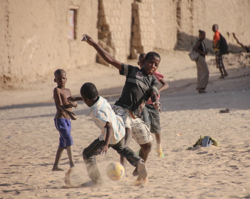 Children play soccer on a sandy square next to the University of Timbuktu, once one of the greatest centers of Islamic scholarship. Just two years ago - on this very square - Islamic militants carried out brutal public punishments on those who did not comply with their form of Sharia law. Photo by Molly Raskin