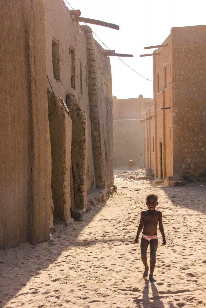 A small girl stands in a desolate alleyway of Timbutku. The city is struggling to recover in the aftermath of the militant occupation and still feels empty; more than half its 50,000 residents fled and have yet to return. It's a sad chapter for a city that once bustled with trade, scholarship and tourism. Photo by Molly Raskin