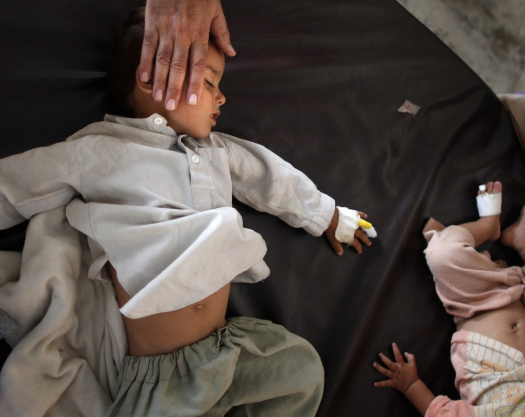 Disease on the Rise A medical office treats a boy at a flood field hospital. Tim Wimborne; REUTERS