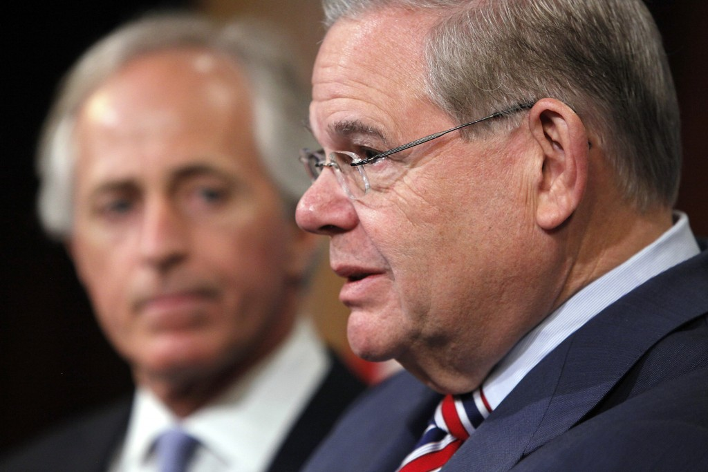 Menendez and Corker hold a news conference after a Senate vote on an aid package for Ukraine at the U.S. Capitol in Washington