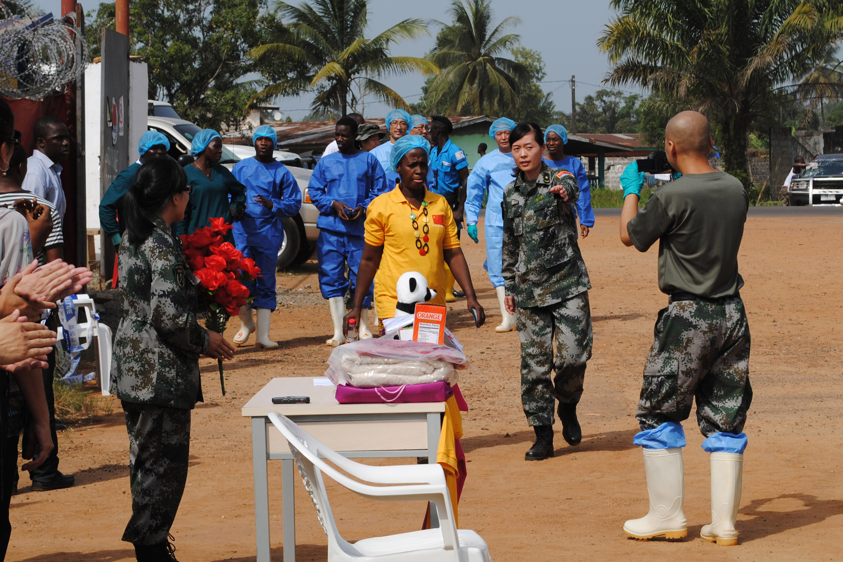 Liberia's last known Ebola patient Beatrice Yardolo (in yellow) arrives for a ceremony at the Chinese Ebola treatment unit, where she was treated, in Monrovia, Liberia, March 5, 2015. REUTERS/James Giahyue (LIBERIA - Tags: DISASTER HEALTH) - RTR4S7WZ