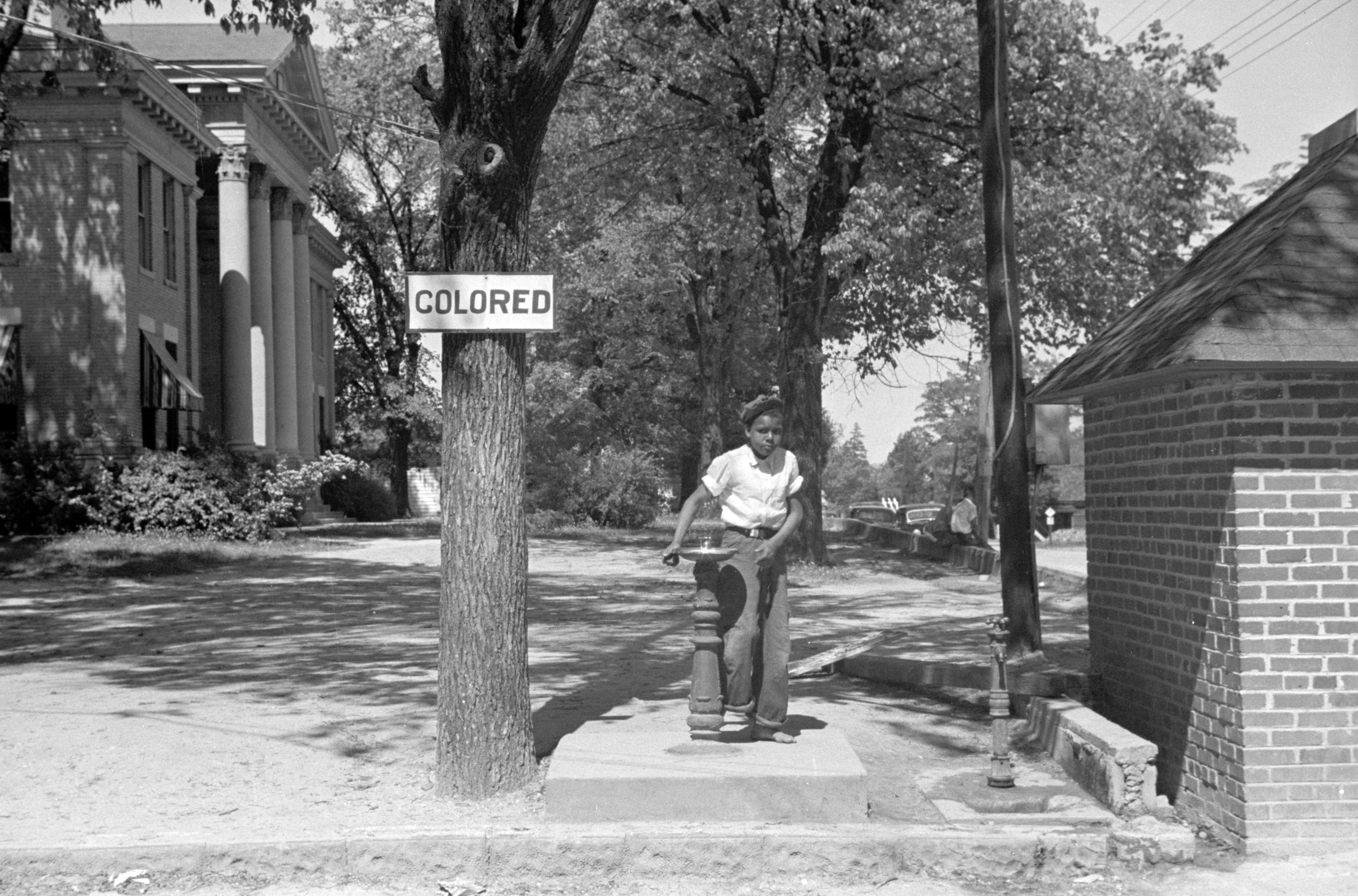 A drinking fountain on the county courthouse lawn in Halifax, North Carolina, in this April 1938 photograph courtesy of the Library of Congress.   REUTERS/Library of Congress/Handout via Reuters - RTR4SDSE