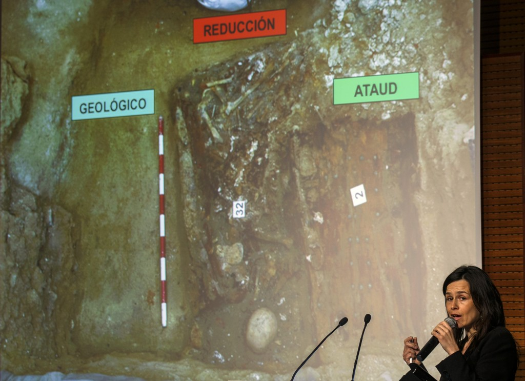Forensic anthropologist Almudena Garcia speaks about the search of the remains of Spanish writer Miguel de Cervantes, in front of a picture of its probable location, in Madrid March 17, 2015. Photo by REUTERS/Andrea Comas