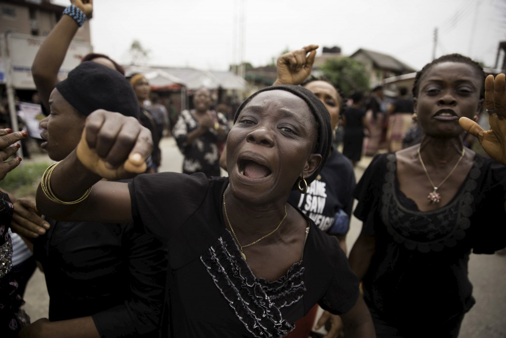 Women from communities in Rivers state in southern Nigeria protest on March 30 against irregularities in voting in the weekend's election. Photo by Afolabi Sotunde/Reuters