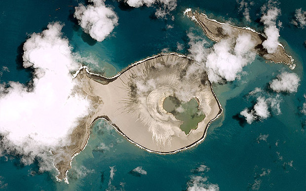 After the eruption the volcano created an above water crater that conjoined with the island on the left creating a new, larger island.  Photo courtesy of Pleiades.