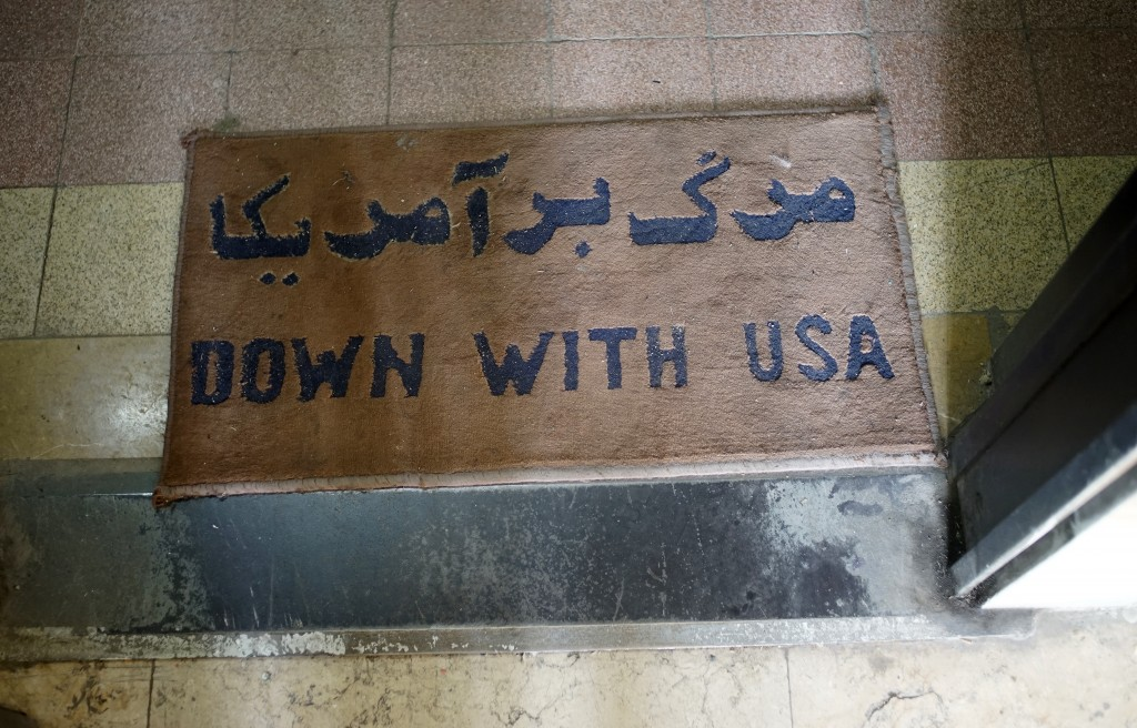 "A ""Down with USA"" mat welcomes visitors to a museum housed in the former embassy."