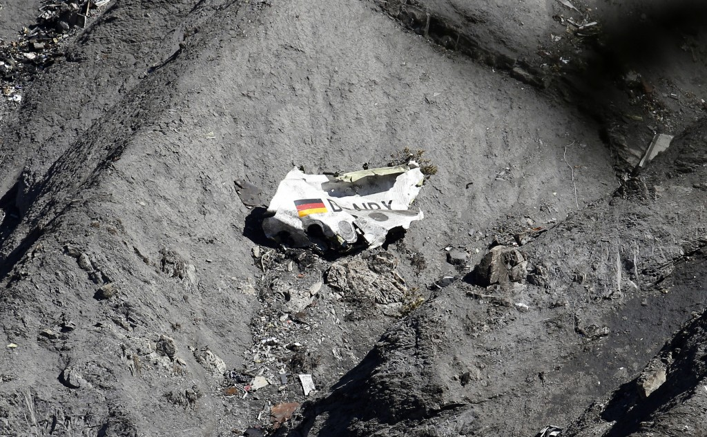 Debris from the Airbus A320 that crashed into a mountainside in the French Alps on Tuesday, killing all 150 people on board. Eerie detail from the final minutes of the flight were released today by French investigators. Photo by Emmanuel Foudrot/Reuters