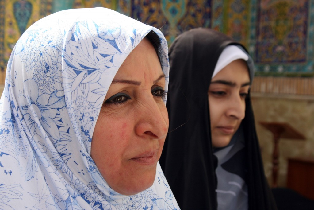 """Annual Visit Janan Jezma and her niece Sara are two of many who make an annual pilgrimage to the shrine. """"Because I am Muslim, I am Shia, I must come here,"""" Jezma says. They came to Najaf from Baghdad, about a four-hour drive. Photo by Larisa Epatko"""