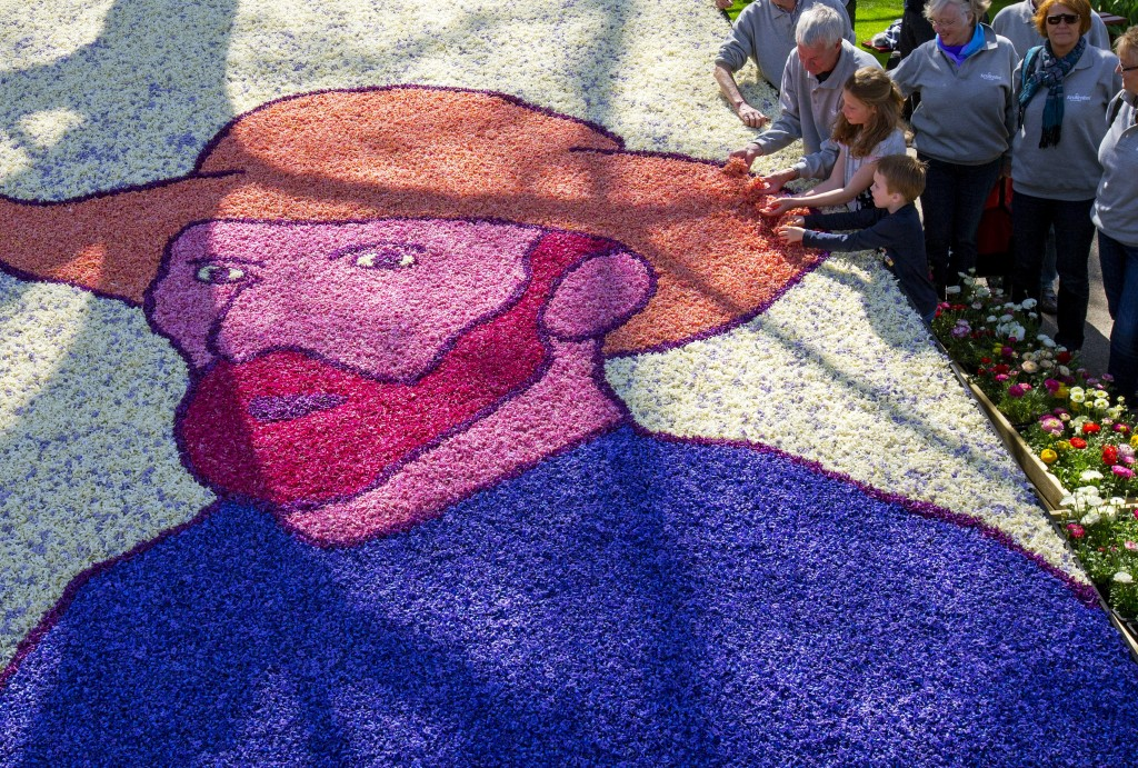 Children place the last petals on a portrait of painter Vincent Van Gogh at the Keukenhof park. Photo: REUTERS/Yves Herman