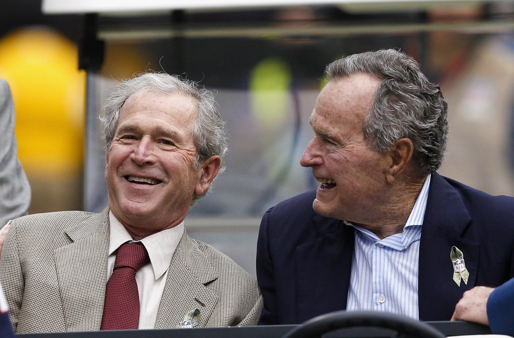 File photo of President George W. Bush, left, and President George H.W. Bush in Houston, Texas in 2013. Photo by Bob Levey/Getty Images