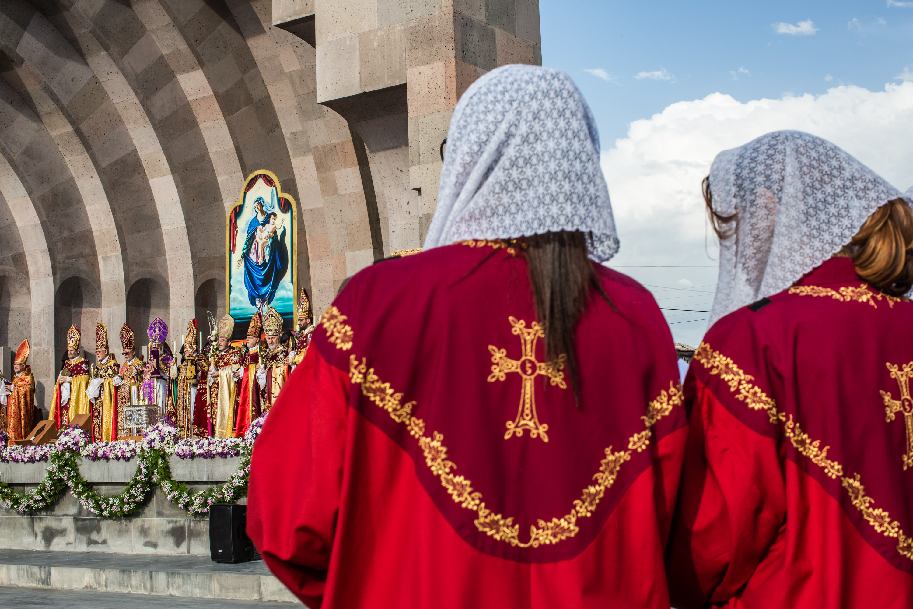 Armenian Apostolic Church leaders conduct a canonization ceremony for victims of the Armenian genocide at the Mother See of Holy Etchmiadzin, a complex that serves as the administrative headquarters of the Armenian Apostolic Church, as members of a choir watch on Thursday in Vagharshapat, Armenia. Photo by Brendan Hoffman/Getty Images