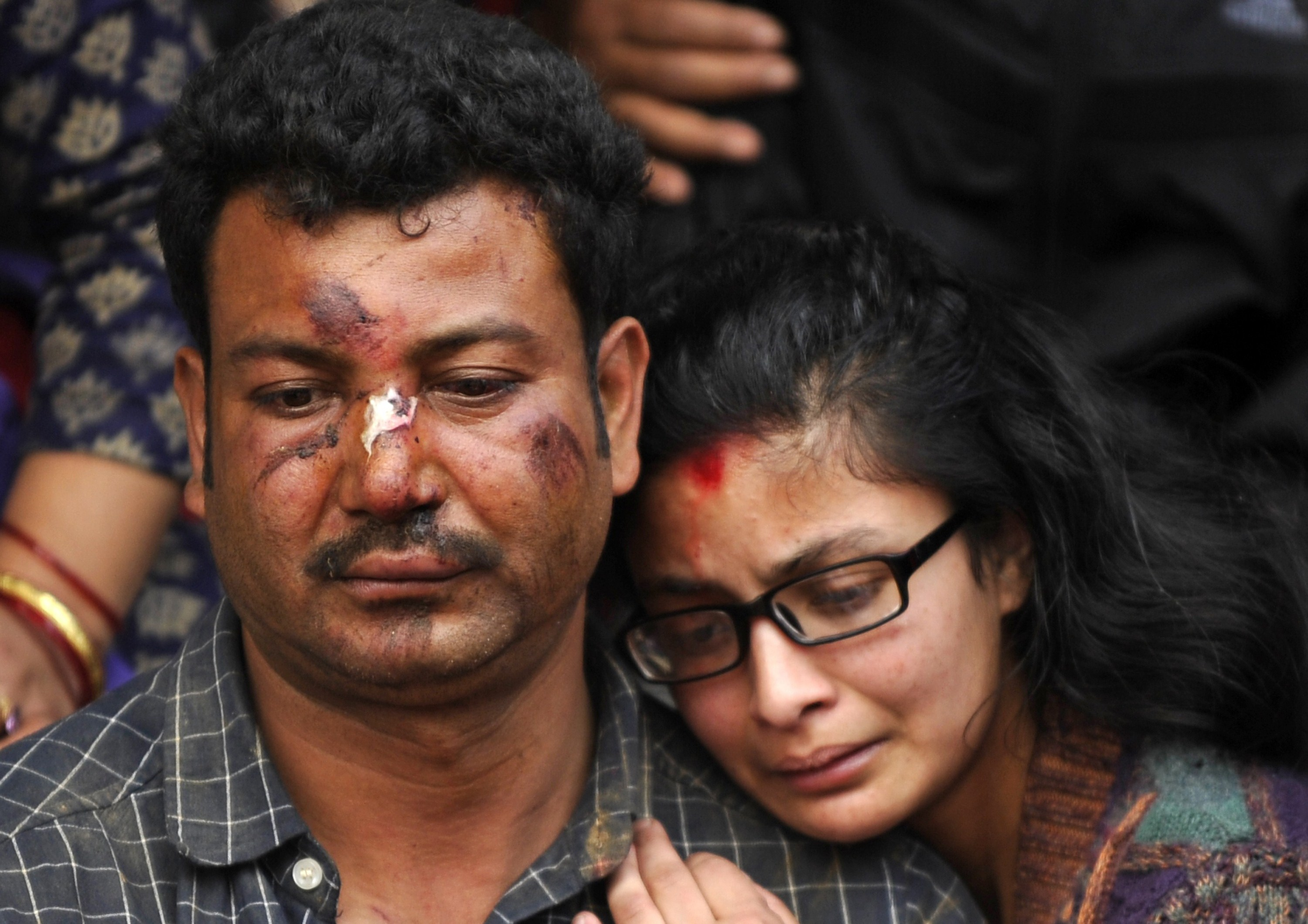 Nepalese residents mourn the death of a relative following an earthquake, at a mass cremation at Pashupatinath in Kathmandu on April 26, 2015. Photo by Prakash Mathema/AFP/Getty Images.