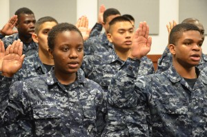 File photo of immigrants who were recruited to join the U.S. Navy taking the oath of citizenship. Photo from Official U.S. Navy Page/Flickr