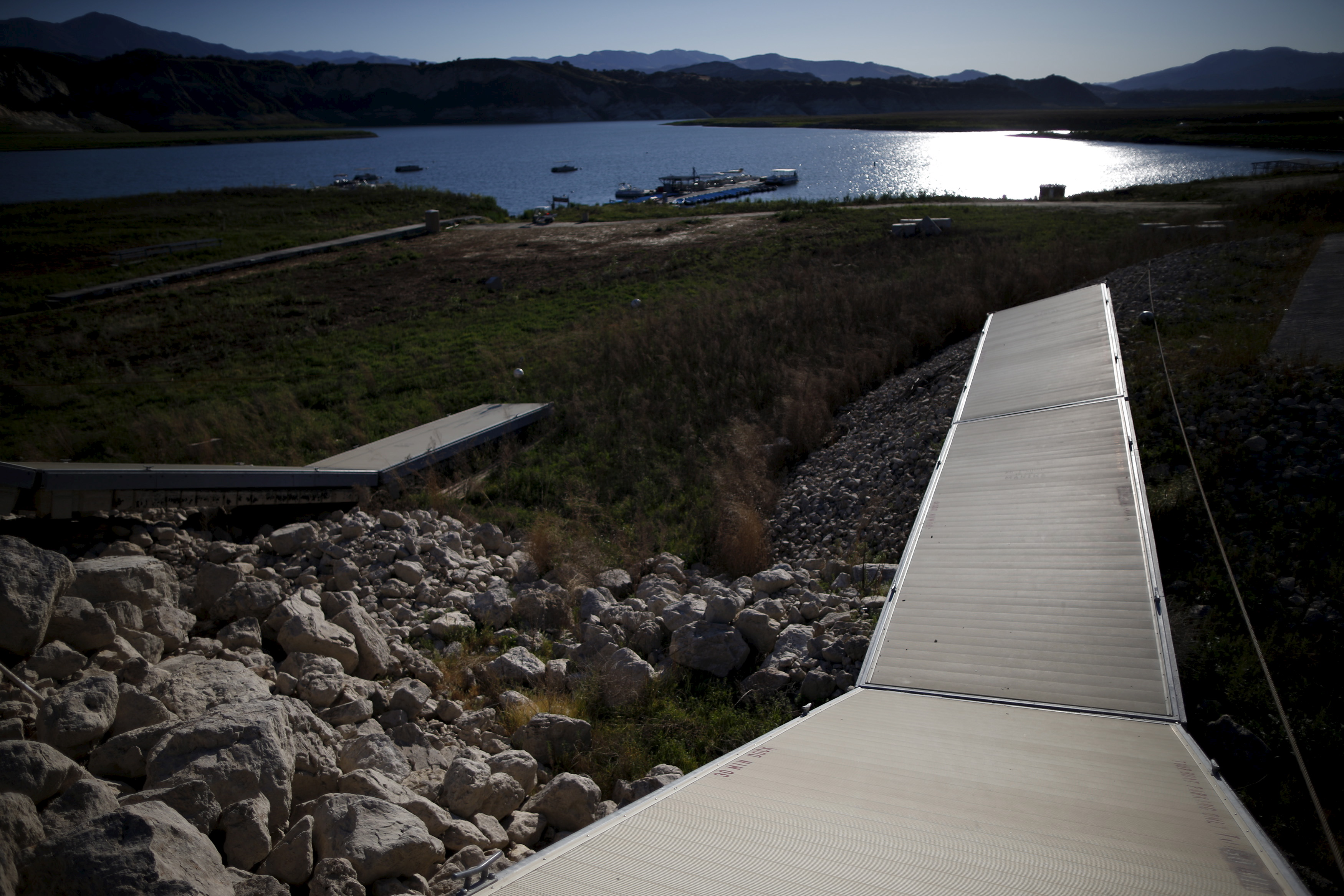 Docks that collapsed when the water receded are seen at Lake Cachuma in Santa Barbara, California March 27, 2015. Photo by Lucy Nicholson/Reuters