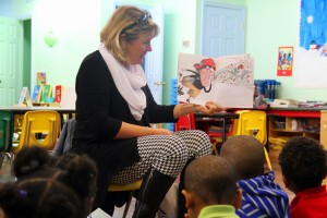 Beverly Hale reads to children at a local daycare as part of the Indianola Promise Community's child literacy program. (Photo: Kayleigh Skinner)