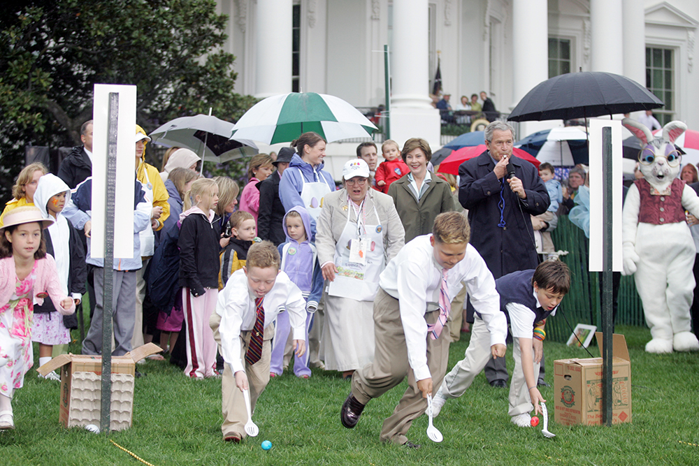 President George W. Bush and Mrs. Laura Bush at the Start of an Easter Egg Roll Race, 2006 (Photo Credit: National Archives/George W. Bush Presidential Library)