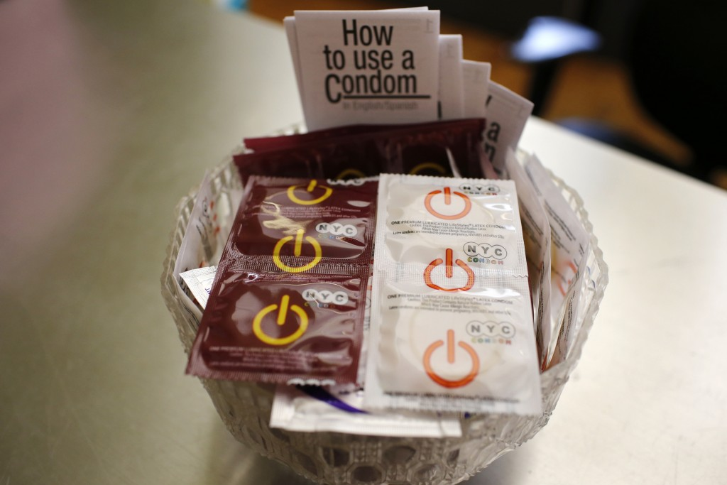 A bowl of free New York City condoms are seen in a lobby at the AIDS Service Center of New York City (ASC/NYC) lower Manhattan headquarters July 3, 2012. Picture taken July 3, 2012. REUTERS/Mike Segar (UNITED STATES - Tags: HEALTH) - RTR3557S