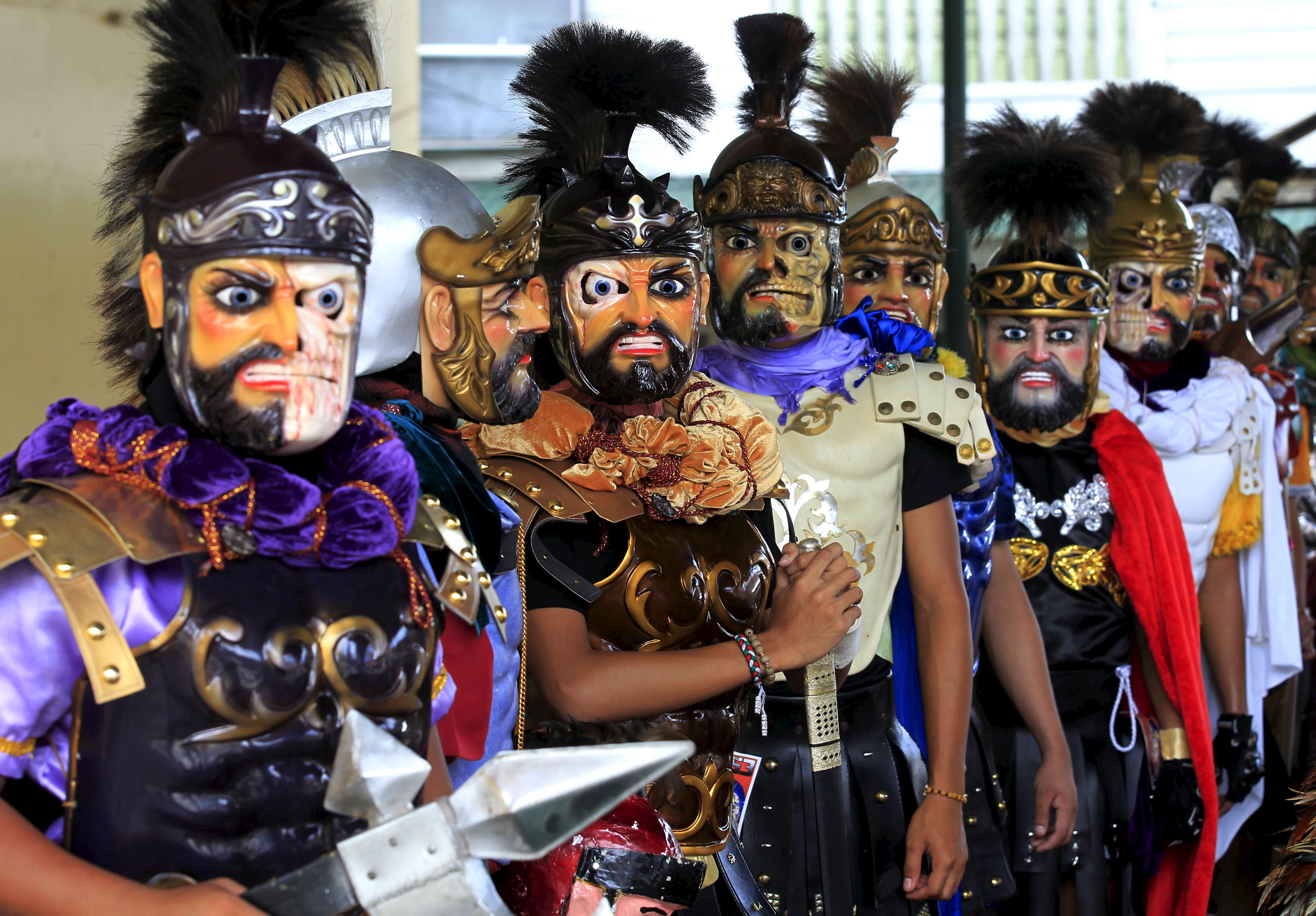 "Penitents called ""Moriones"" parade along the streets of Boac town on Marinduque island in central Philippines April 1, 2015. During the annual festival, masked and costumed penitents called ""Moriones"" dress in attire that is the local interpretation of what Roman soldiers wore during biblical times. Holy Week is celebrated in many Christian traditions during the week before Easter. REUTERS/Romeo Ranoco"