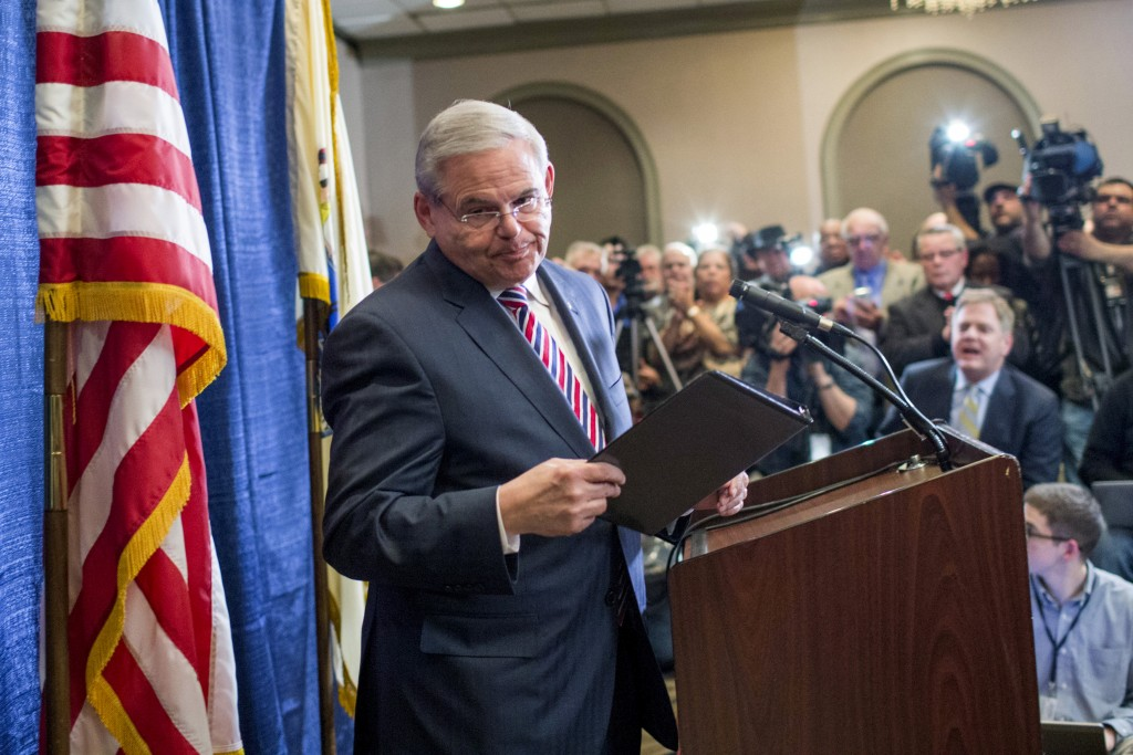 "Senator Bob Menendez (D-NJ) exits the podium after speaking to the media during a news conference in Newark, New Jersey, April 1, 2015. Menendez said on Wednesday he was outraged at the U.S. Justice Department's move to indict him on corruption charges and vowed ""he will be vindicated."" REUTERS/Eduardo Munoz TPX IMAGES OF THE DAY - RTR4VT5E"
