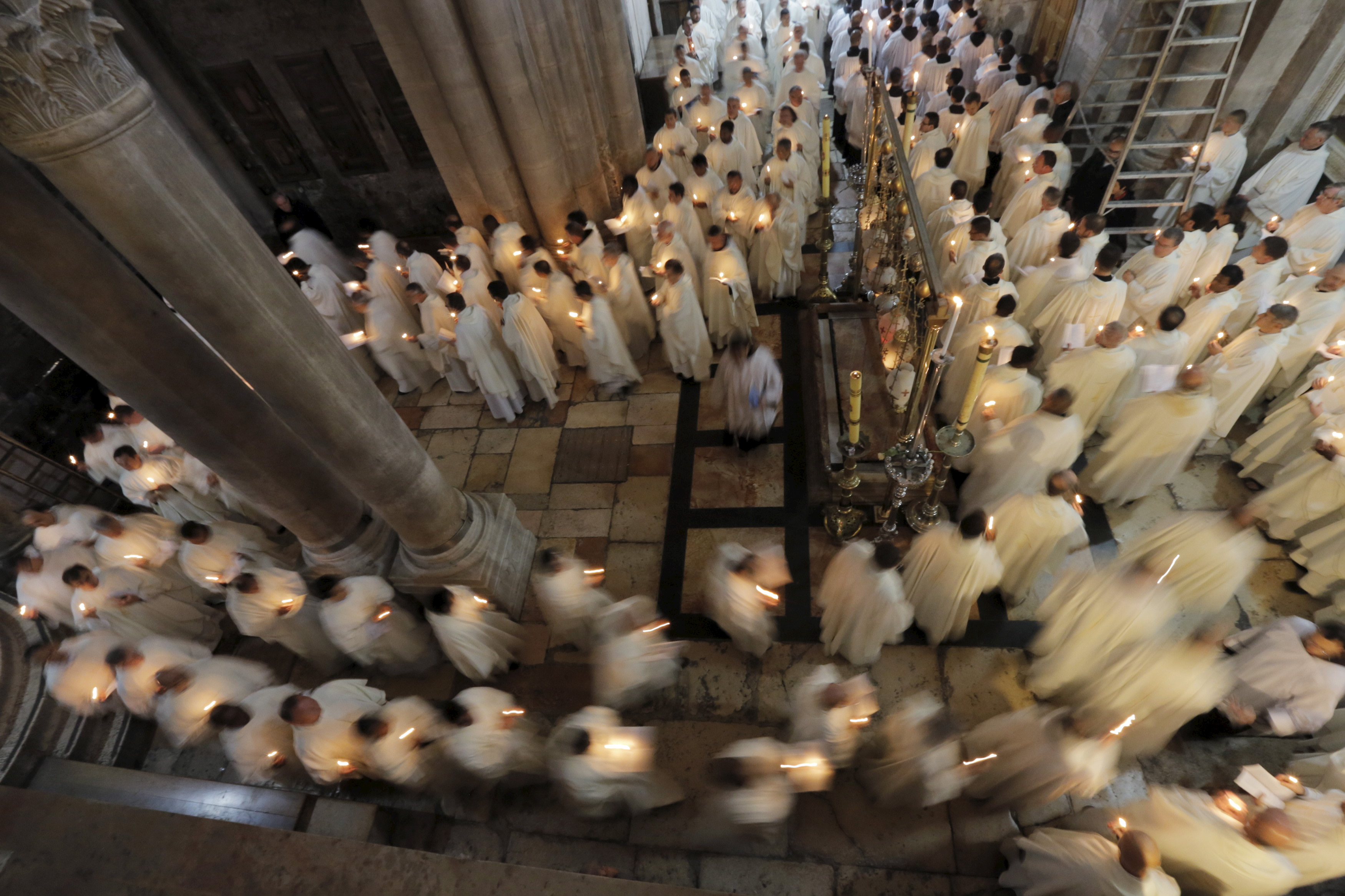 Members of the Catholic clergy hold candles during a procession at the traditional Washing of the Feet ceremony at the Church of the Holy Sepulchre in Jerusalem's Old City during Holy Week April 2, 2015. Holy Week is celebrated in many Christian traditions during the week before Easter. REUTERS/Ammar Awad