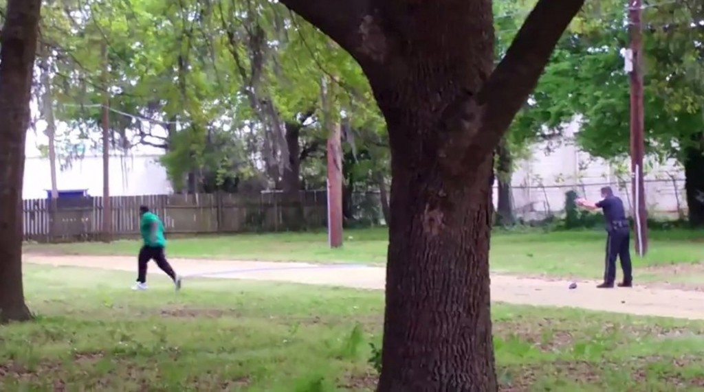 North Charleston police officer Michael Slager, right, is seen shooting 50-year-old Walter Scott in the back as he runs away, in this still image from video in North Charleston, South Carolina taken April 4, 2015. Handout photo via Reuters