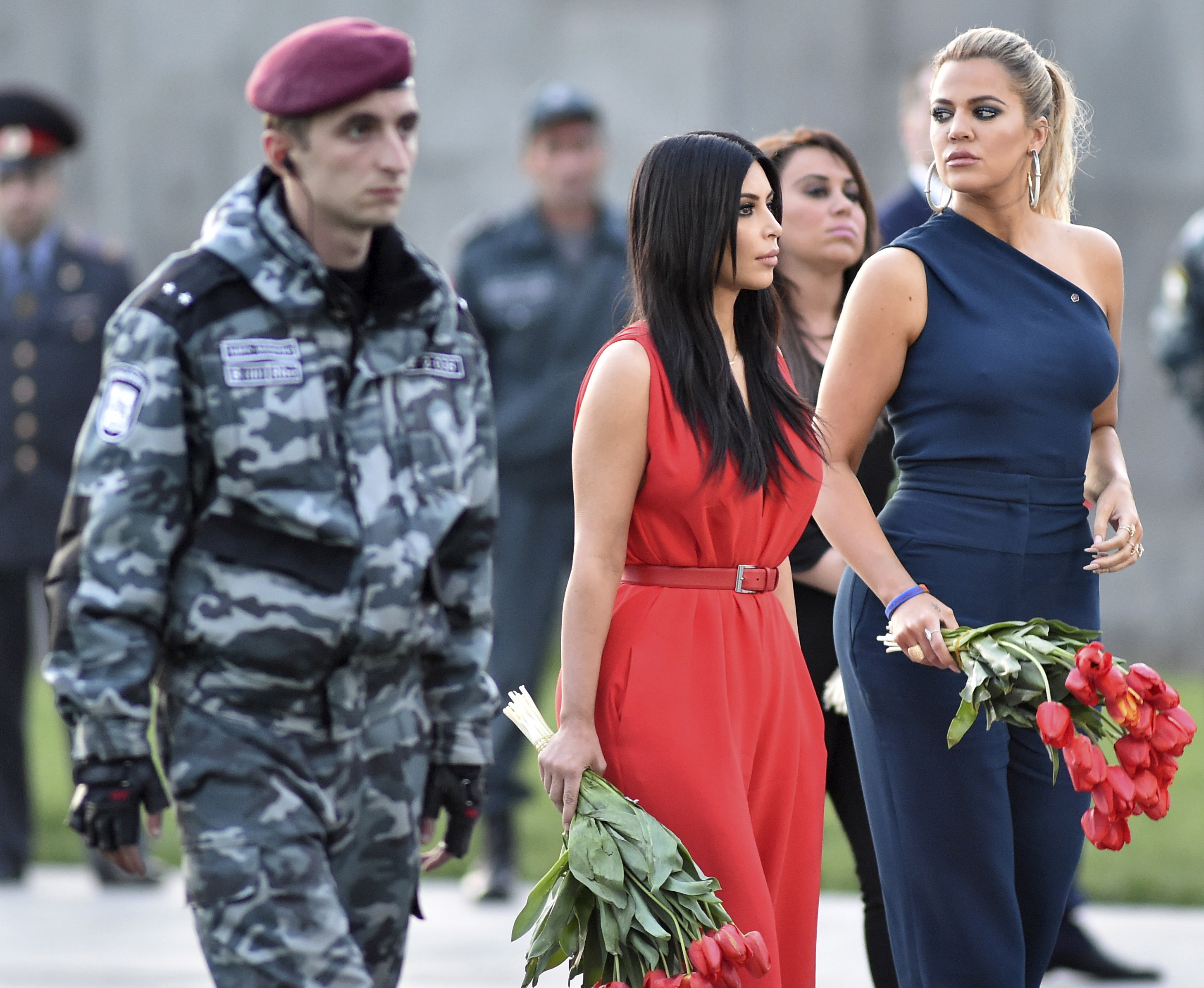 Television reality stars Kim Kardashian (center) and her sister Khloe Kardashian visit their ancestral homeland of Armenia and lay flowers at the Tsitsernakaberd  Armenian Genocide Memorial and Museum in Yerevan on April 10. Photo by Hayk Baghdasaryan/Photolure via Reuters