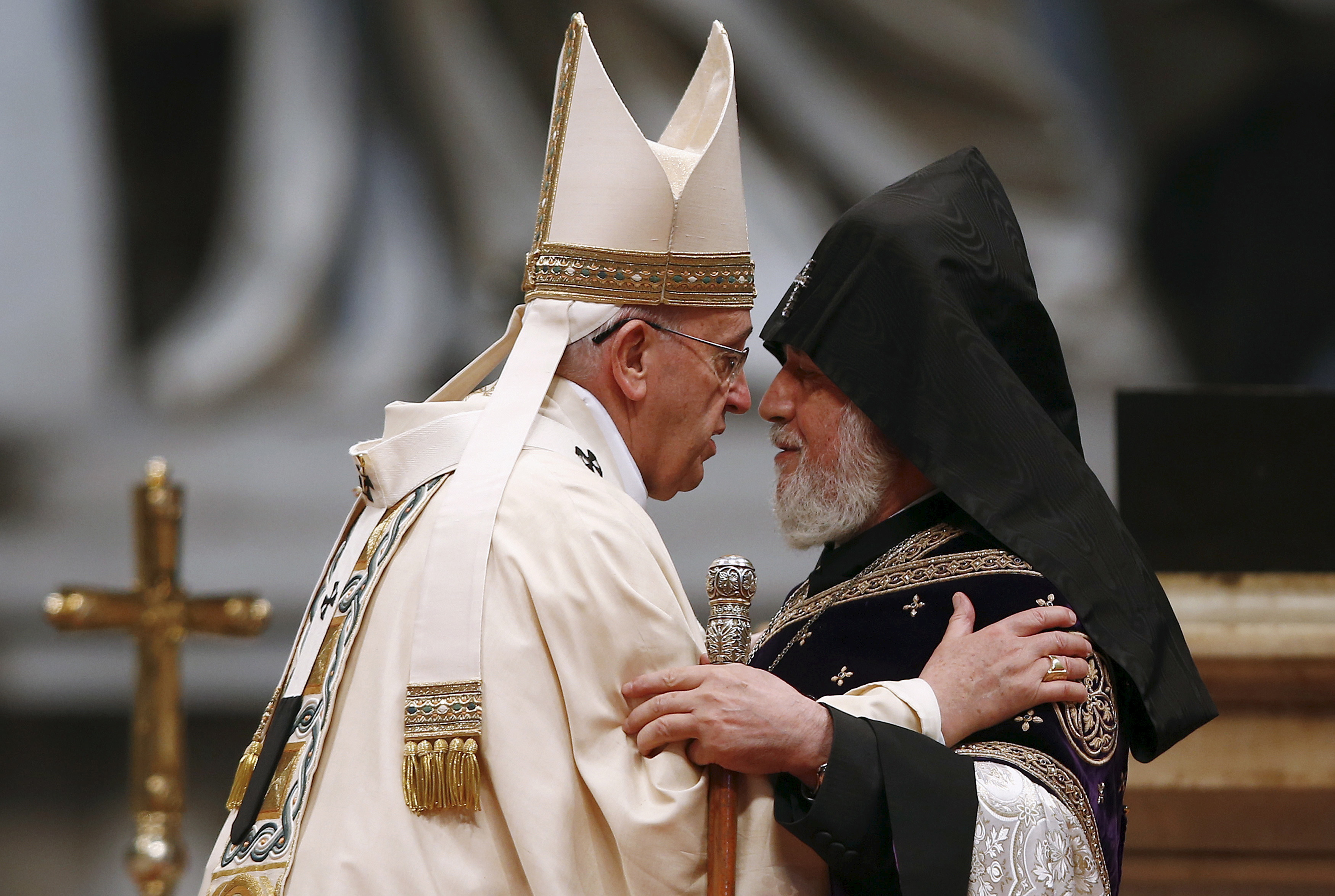 "Pope Francis (left) embraces Catholicos of All Armenians Karekin II during a mass on the 100th anniversary of the Armenian mass killings, in St. Peter's Basilica at the Vatican on April 12. He called on the international community to acknowledge the Armenian ""genocide"" at the service. Photo by Tony Gentile/Reuters"