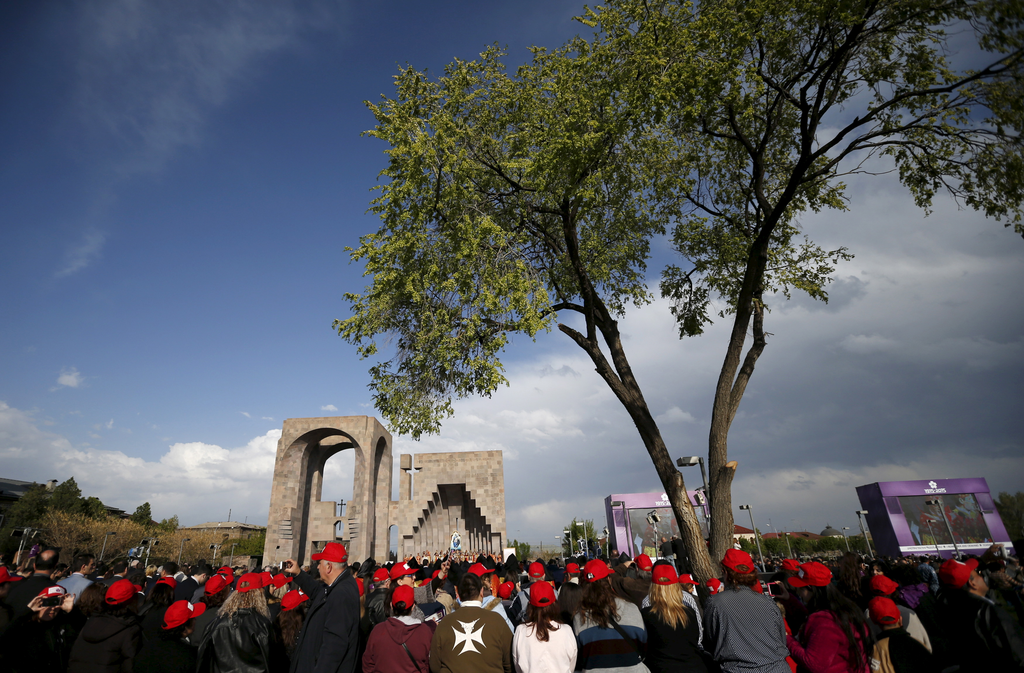 People attend a canonization ceremony for the victims of mass killings of Armenians by Ottoman Turks at the open-air altar of Armenia's main cathedral in Echmiadzin on Thursday. Photo by David Mdzinarishvili/Reuters