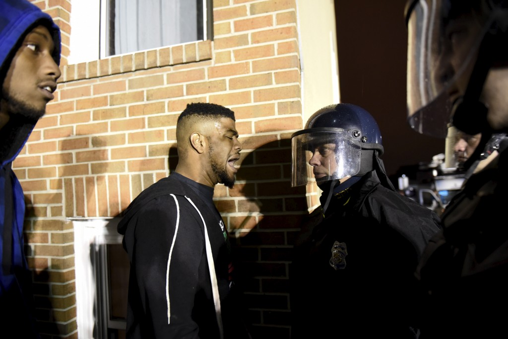 Demonstrators confront law enforcement officers near the Baltimore Police Department's Western District to protest against the death of Freddie Gray in police custody on April 25, 2015. Photo by Sait Serkan Gurbuz/Reuters