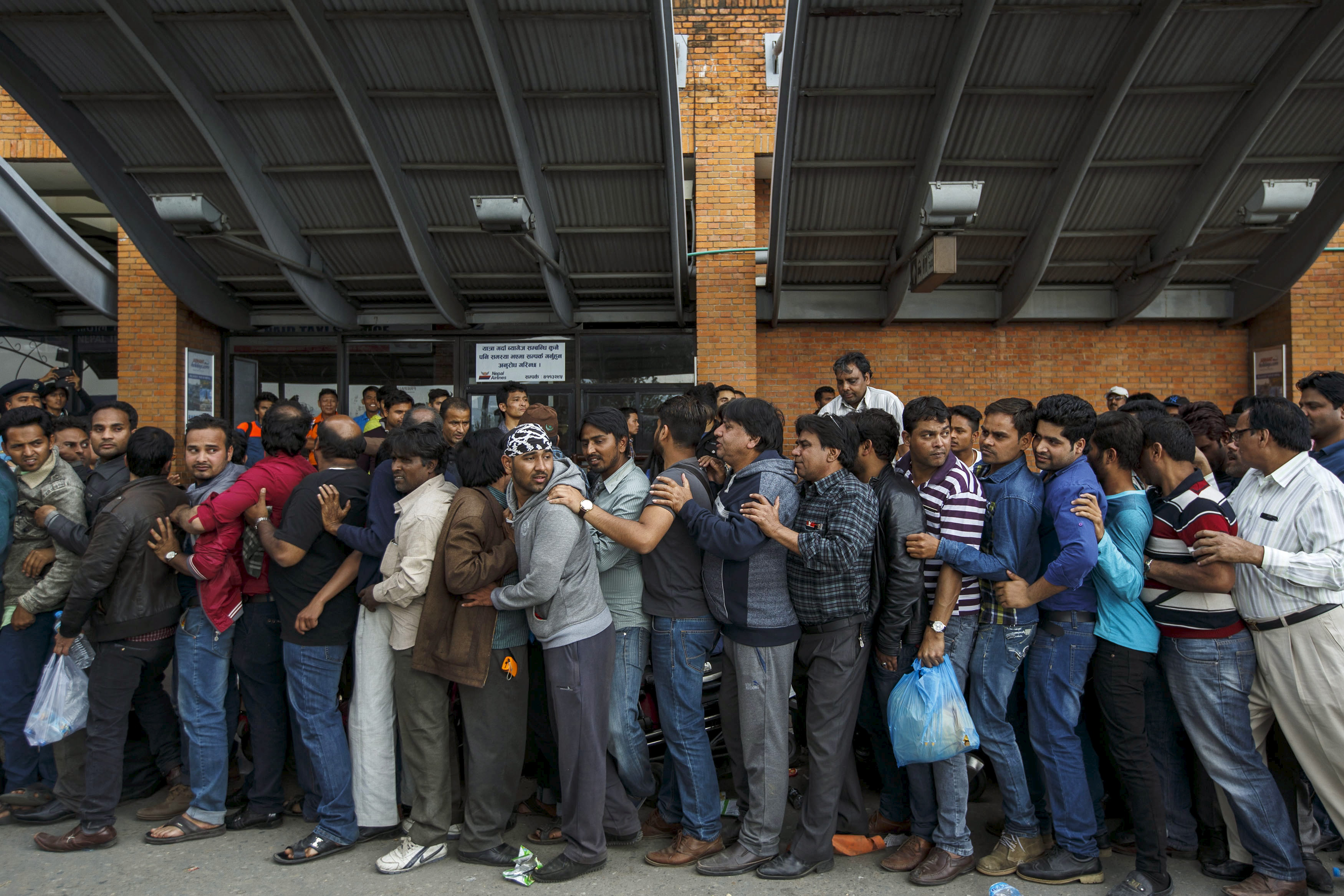 Indians queue up as they wait for an aircraft to evacuate to their country at Nepal's Tribhuvan International Airport a day after a 7.9 magnitude earthquake, in Kathmandu, Nepal April 26, 2015. Photo by Athit Perawongmetha/REUTERS.