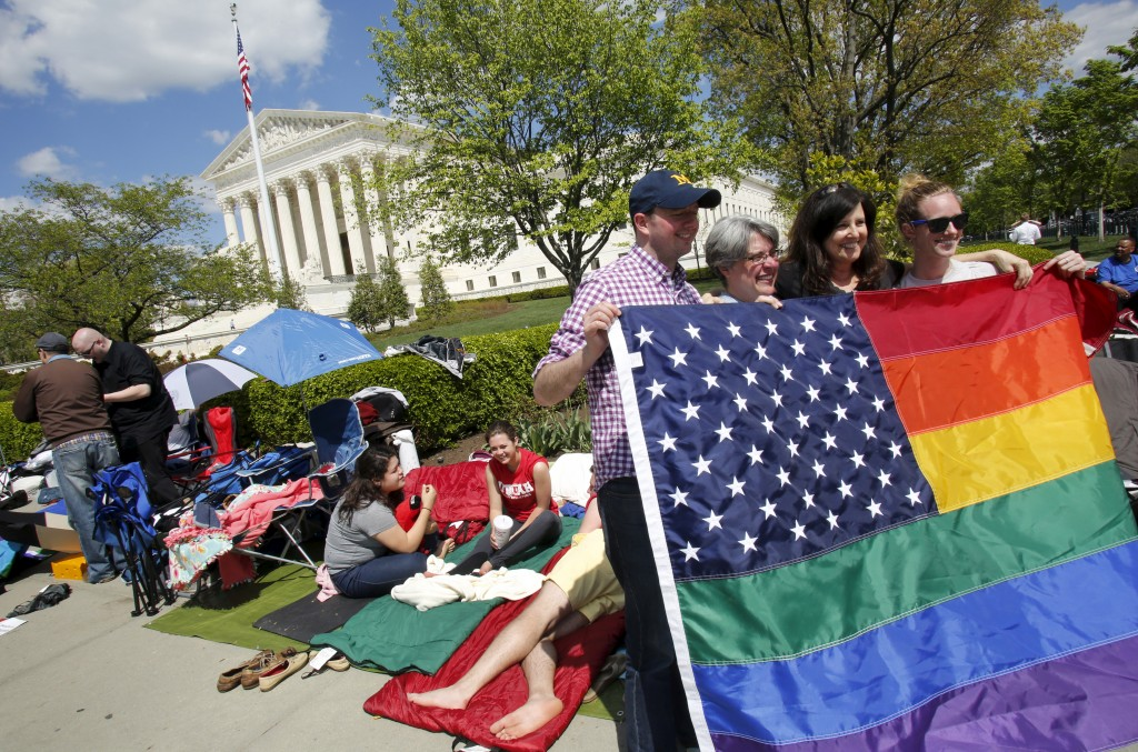 People lined up outside the Supreme Court Monday ahead of arguments focusing on gay marriage. Photo by Yuri Gripas/Reuters