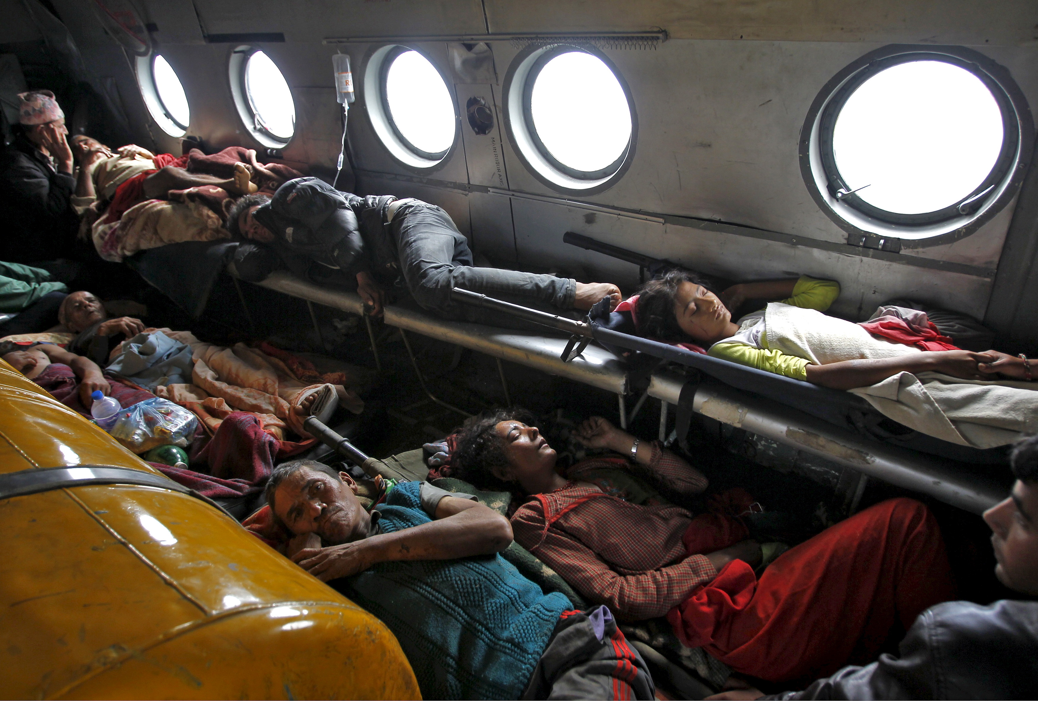 Those injured from Saturday's earthquake lie inside an Indian Air Force helicopter as they are evacuated from Trishuli Bazar to the airport in Kathmandu, Nepal on Monday. Photo by Jitendra Prakash/Reuters