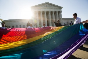 Gay marriage supporters hold a gay rights flag in front of the Supreme Court before a hearing about gay marriage in Washington, D.C. in 2015. Photo by Joshua Roberts/Reuters