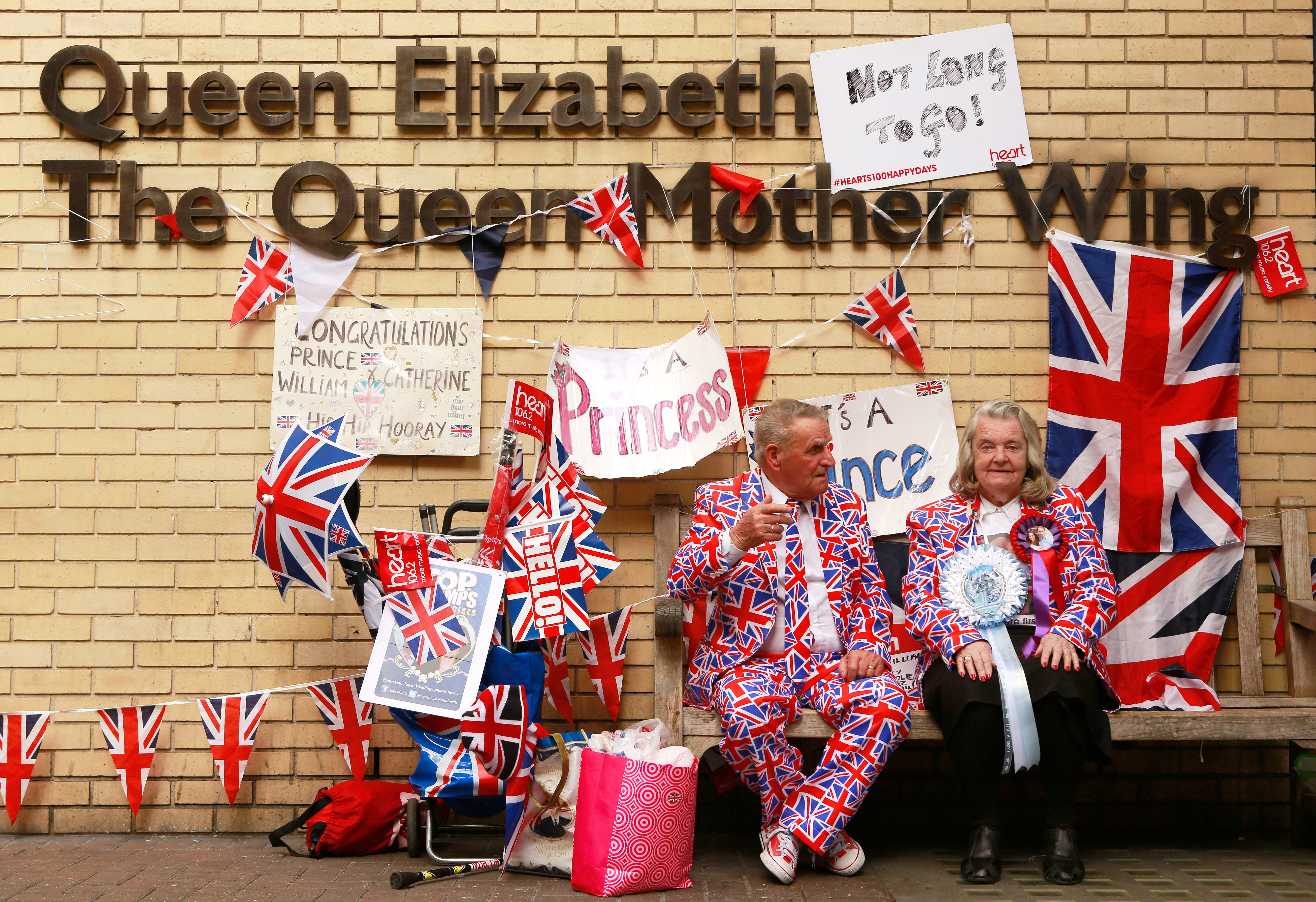 Royal enthusiasts sit outside the Lindo wing of St. Mary's Hospital where Duchess of Cambridge Kate Middleton gave birth to her second child on May 2, 2015. REUTERS/Cathal McNaughton