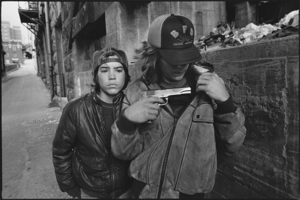 """Rat"" and Mike with a gun, Seattle, Washington, 1983. Photo by Mary Ellen Mark"