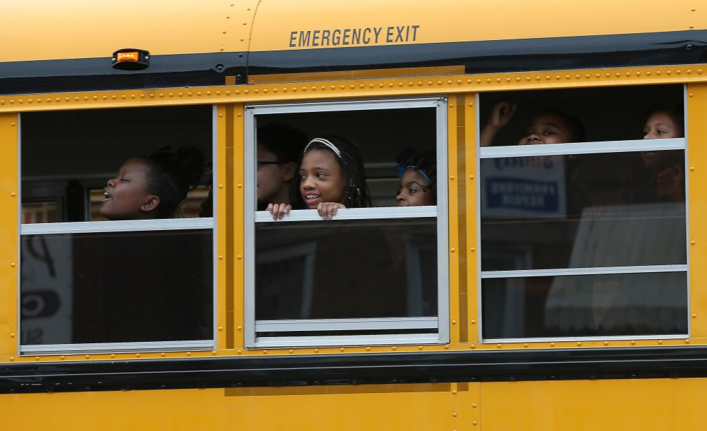 Children riding home from school on a school bus. File photo by Win McNamee/Getty Images
