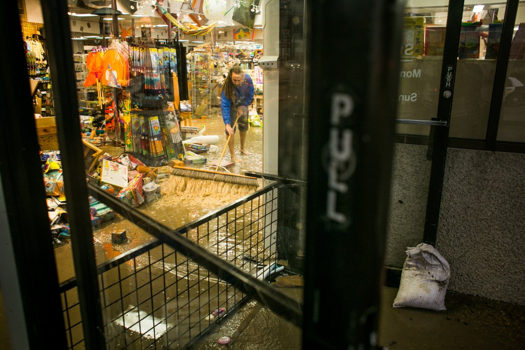 Drew Anthony Smith / Stringer Caption:AUSTIN, TX - MAY 25: Ben Sioberman works to get water out of the flooded Whole Earth Provisions Company on Lamar Street after days of heavy rain on May 25, 2015 in Austin, Texas. Texas Gov. Greg Abbott toured the damage zone where one person is confirmed dead and at least 12 others missing in flooding along the Rio Blanco, which reports say rose as much as 40 feet in places, caused by more than 10 inches of rain over a four-day period. The governor earlier declared a state of emergency in 24 Texas counties. (Photo by Drew Anthony Smith/Getty Images)