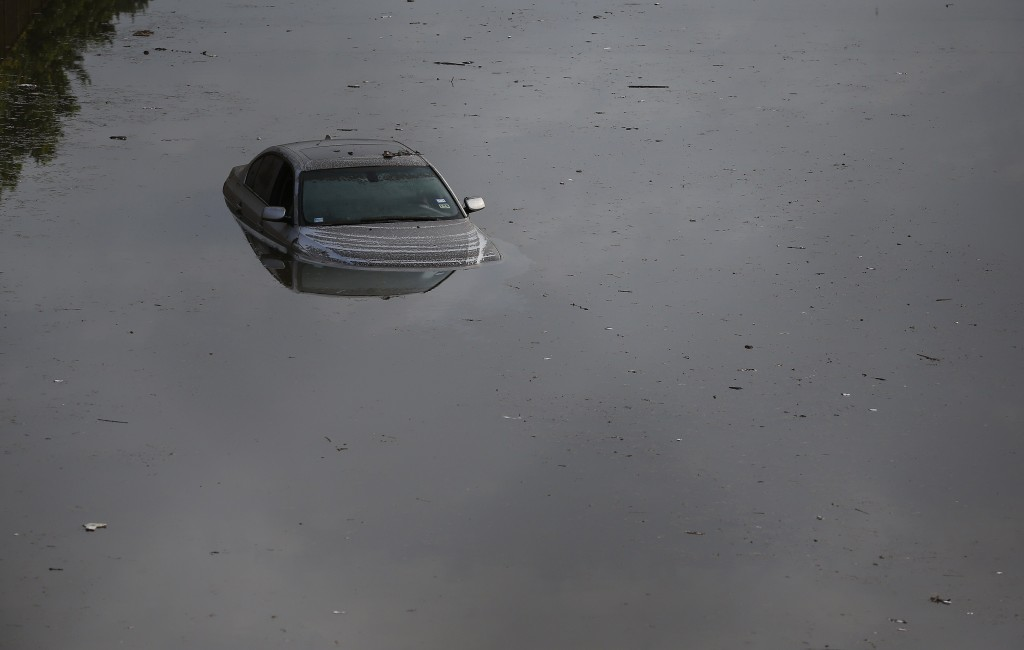 A vehicle left stranded on a flooded Interstate 45 in Houston, Texas on May 26, 2015.  Heavy rains throught Texas put the city of Houston under massive ammounts of water, closing roadways and trapping residents in their cars and buildings, according to local reports. Rainfall reached up to 11 inches(27.9cm) in some parts of the state, national forecasters reported, and the heavy rains quickly pooled over the state's already saturated soil. AFP PHOTO/AARON M. SPRECHER        (Photo credit should read Aaron M. Sprecher/AFP/Getty Images)