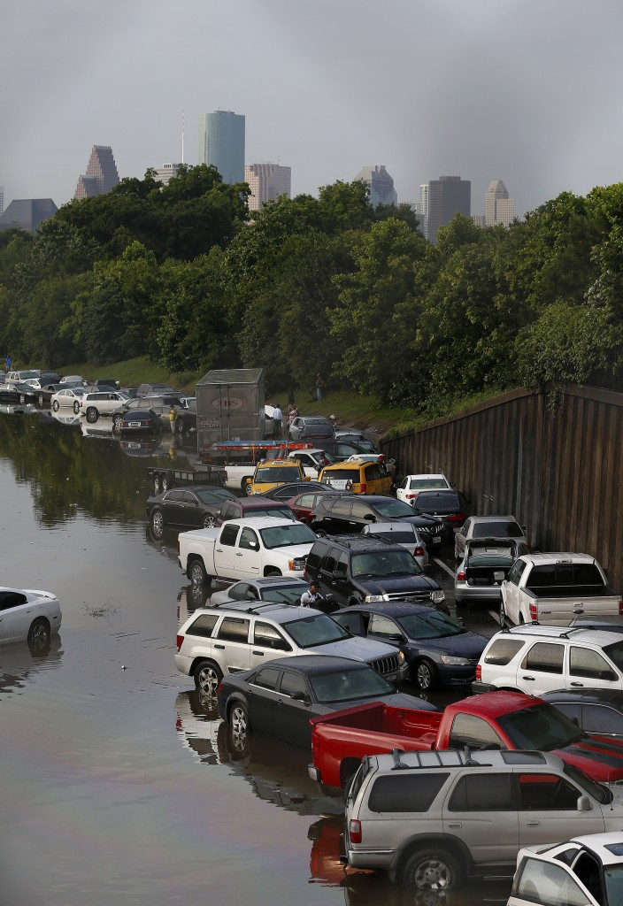 AARON M. SPRECHER / Stringer Caption:Vehicles left stranded on a flooded Interstate 45 in Houston, Texas on May 26, 2015. Heavy rains throught Texas put the city of Houston under massive ammounts of water, closing roadways and trapping residents in their cars and buildings, according to local reports. Rainfall reached up to 11 inches(27.9cm) in some parts of the state, national forecasters reported, and the heavy rains quickly pooled over the state's already saturated soil. AFP PHOTO/AARON M. SPRECHER (Photo credit should read Aaron M. Sprecher/AFP/Getty Images)
