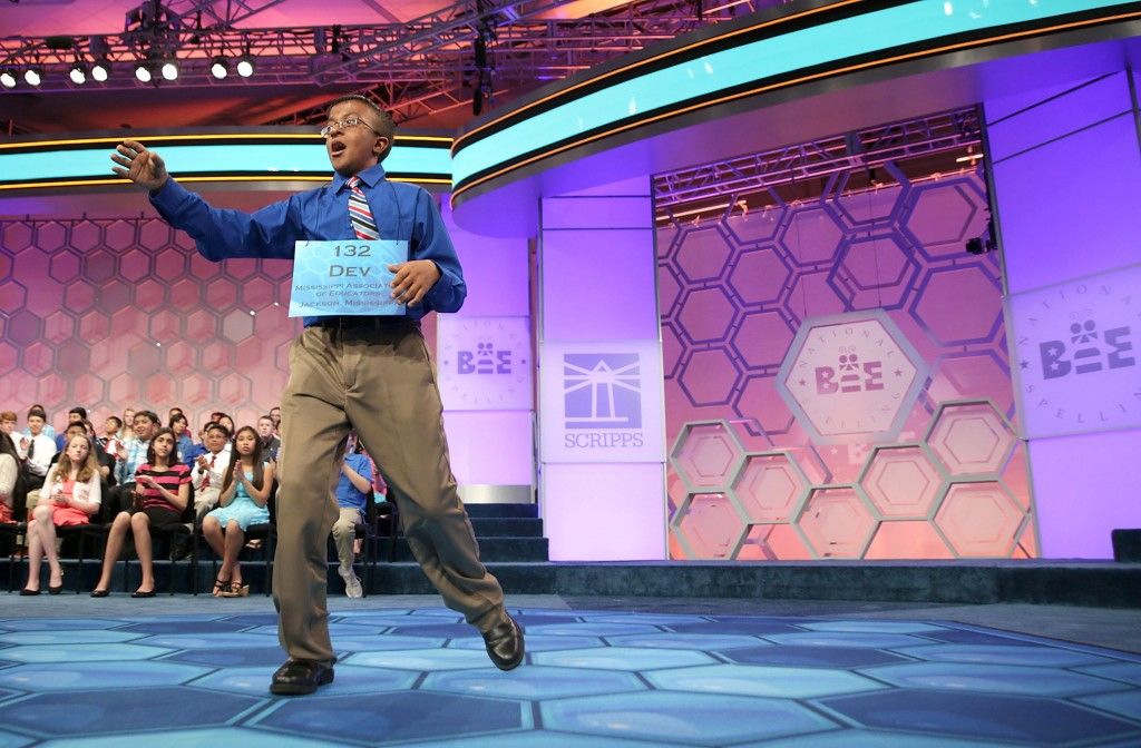 NATIONAL HARBOR, MD - MAY 28: Speller Dev Jaiswal of Jackson, Mississippi, reacts after correctly spelling his word during round seven of the 2015 Scripps National Spelling Bee May 28, 2015 in National Harbor, Maryland. Ten spellers have advanced to the finals. (Photo by Alex Wong/Getty Images)